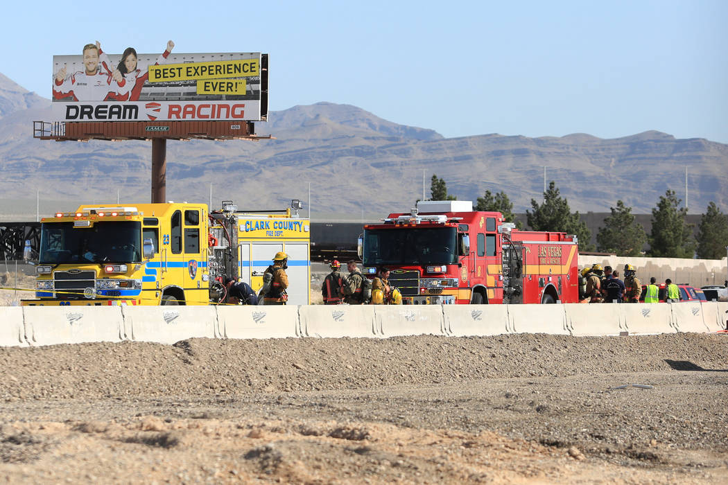 Las Vegas and Clark County firefighters work to clean a spill that has shutdown all southbound lanes on I-15 near Lamb Boulevard on Thursday, April 13, 2017. Brett Le Blanc Las Vegas Review-Journa ...