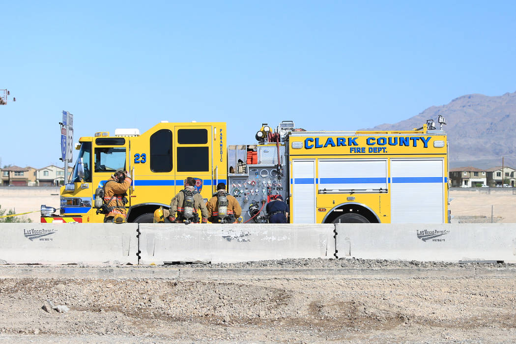 Clark County firefighters work to clean a spill that has shutdown all southbound lanes on I-15 near Lamb Boulevard on Thursday, April 13, 2017. Brett Le Blanc Las Vegas Review-Journal @bleblancphoto
