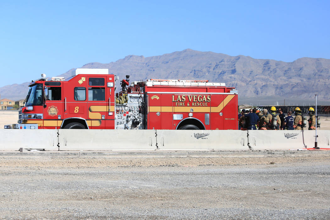 Las Vegas firefighters work to clean a spill that has shutdown all southbound lanes on I-15 near Lamb Boulevard on Thursday, April 13, 2017. Brett Le Blanc Las Vegas Review-Journal @bleblancphoto
