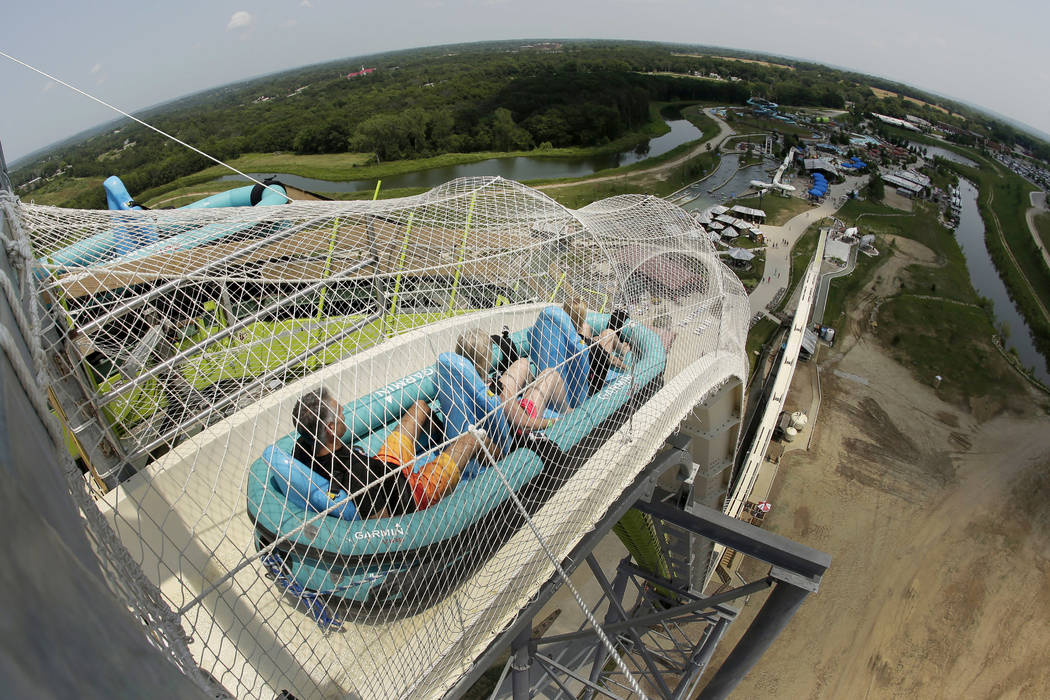 Riders go down the Verruckt waterslide at Schlitterbahn Waterpark in Kansas City, Kan. The family of Caleb Schwab, a Kansas lawmaker's son who was killed Aug. 7, 2016, on the ride, has reached a s ...
