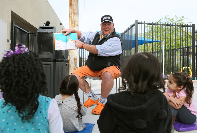 """Celebrity Chef Mario Batali reads """"Green Eggs and Ham,"""" by Dr. Seuss to children near the new Books for Kids Library at Acelero Spring Valley Learning Center on Tuesday, March 29, 2016, in Las Veg ..."""