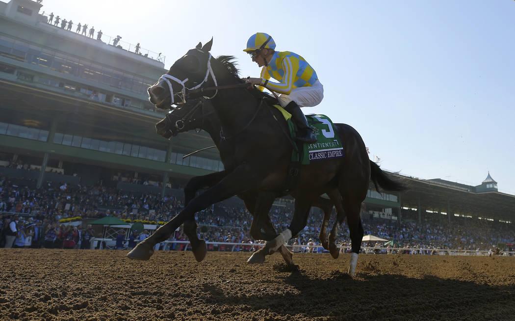 Classic Empire, with jockey Julien Leparoux, wins the Breeders' Cup Juvenile horse race at Santa Anita, Saturday, Nov. 5, 2016, in Arcadia, Calif. (AP Photo/Mark J. Terrill)