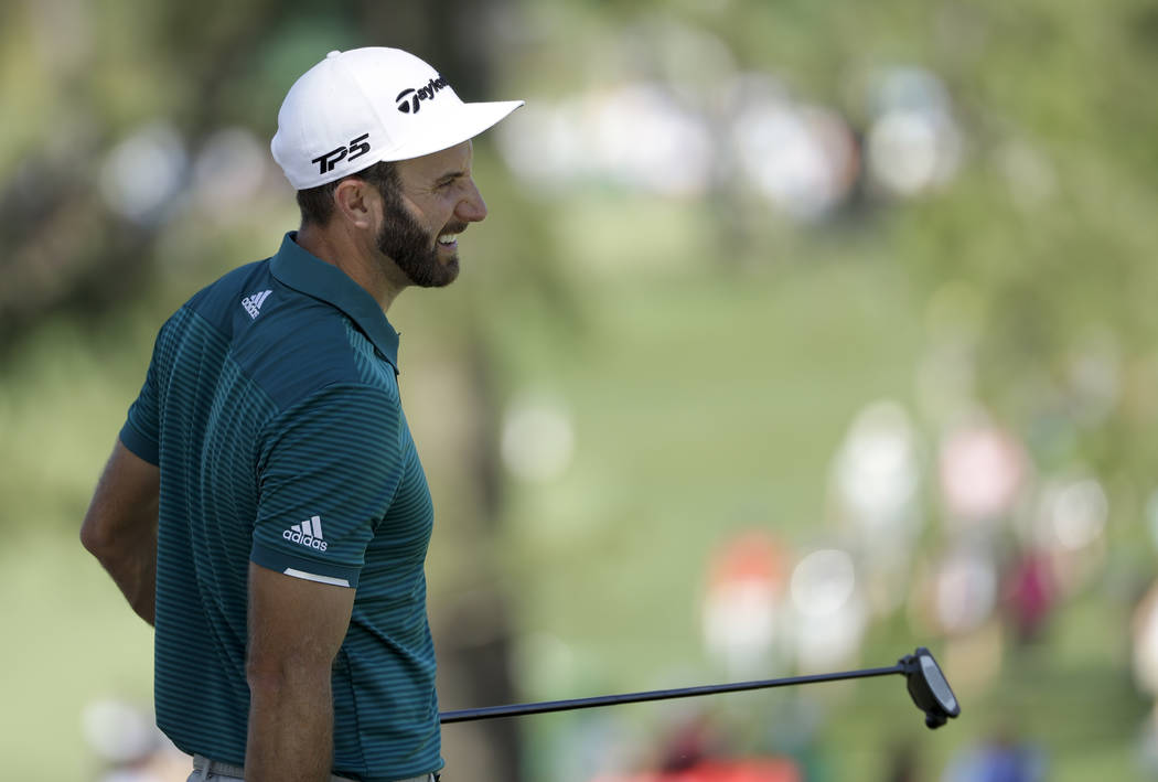 Dustin Johnson smiles on the seventh green during a practice round for the Masters golf tournament Tuesday, April 4, 2017, in Augusta, Ga. (Matt Slocum/AP)
