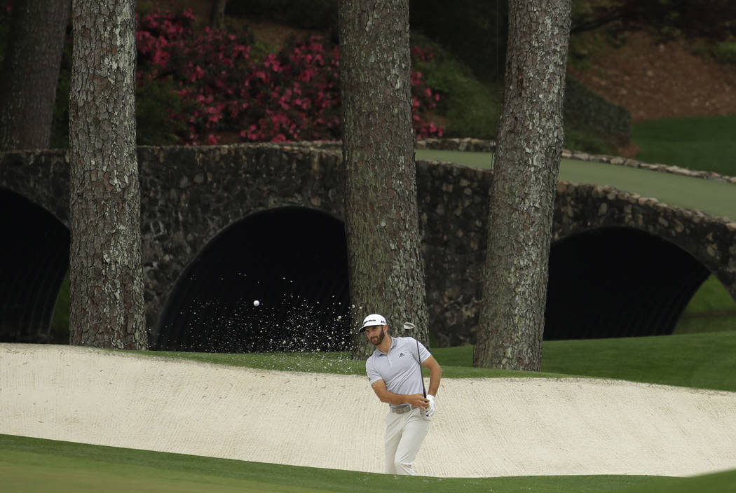 Dustin Johnson hits to the 11th hole during a practice round for the Masters golf tournament Wednesday, April 5, 2017, in Augusta, Ga. (Charlie Riedel/AP)