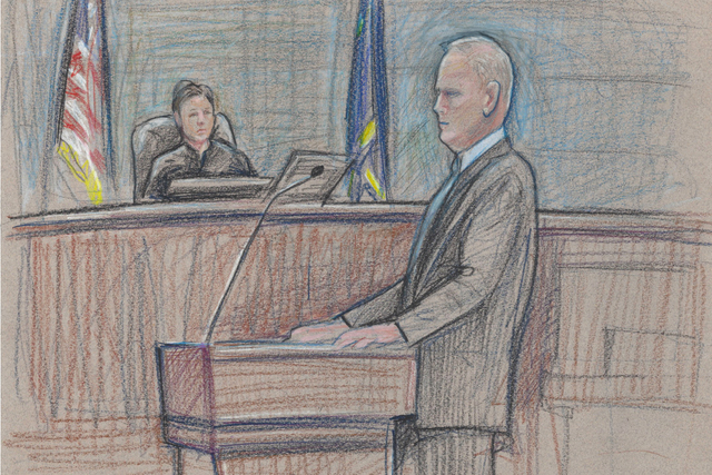 First Assistant U.S. Attorney Steven Myhre is depicted, with U.S. District Judge Gloria Navarro in the background, during his opening statement to jurors in the first Las Vegas trial against assoc ...
