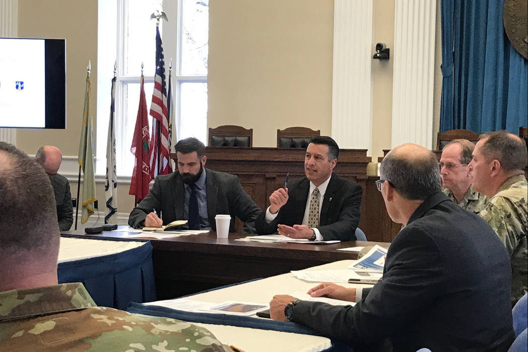 Gov. Brian Sandoval, center, holds a briefing Thursday, April 13, 2017 in Carson City with emergency managers and public safety officials to discuss preparations for the spring snowmelt and Northe ...