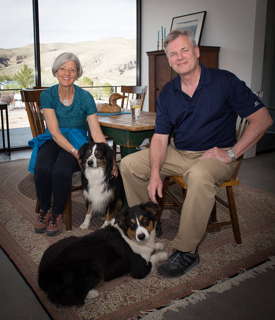 Scott and Laurie Lee with their dogs in their Blue Diamond home. (Tonya Harvey Real Estate Millions)