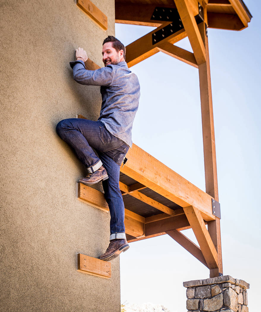 An avid hiker and climber, Guy Pinjuv gets to his balcony by climbing up the side of his home. (Tonya Harvey)