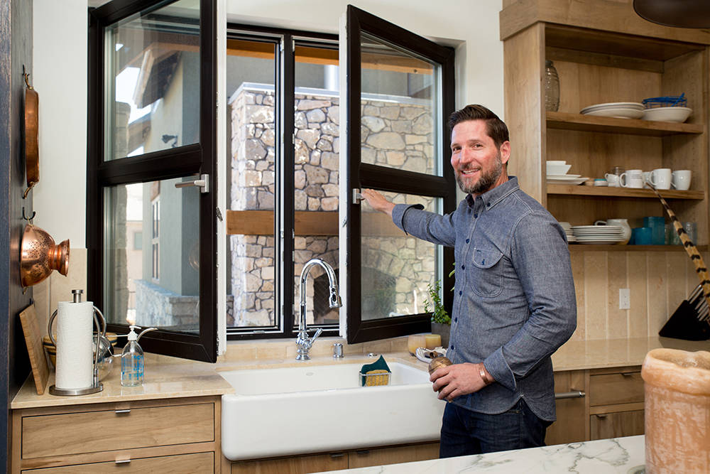 Guy Pinjuv in his kitchen. He designed the home to conserve water and energy. (Tonya Harvey)