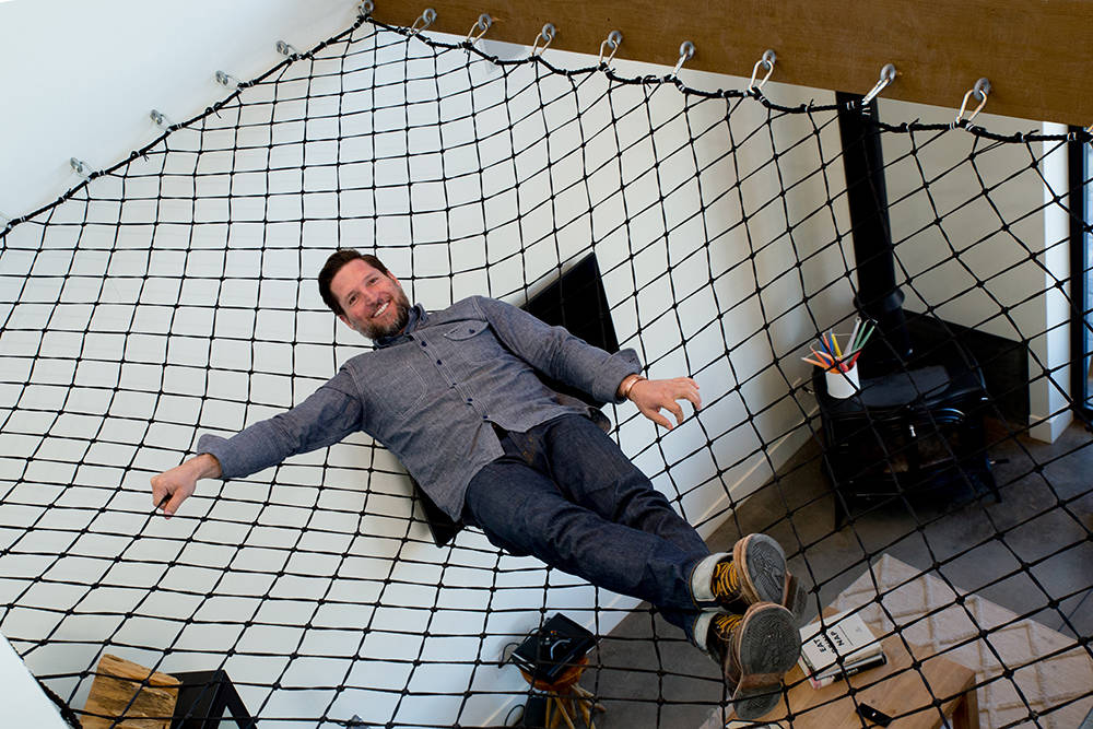 Guy Pinjuv had riggers that work on Strip shows install a hammock that is capable of holding 5,000 pounds. It hangs over a corner of his living room. (Tonya Harvey)