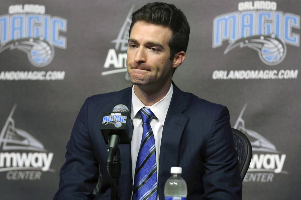 In this Feb. 5, 2015, file photo, Orlando Magic general manager Rob Hennigan pauses to answer a question during a news conference in Orlando, Fla. The Orlando Magic have fired general manager Rob  ...