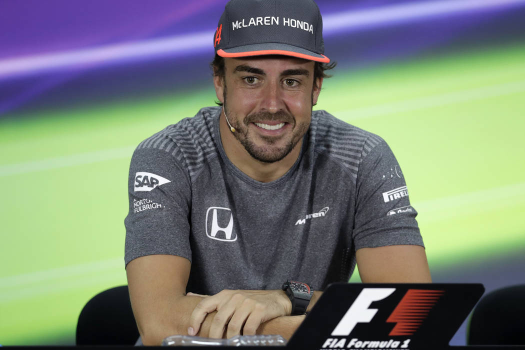 McLaren driver Fernando Alonso of Spain speaks to reporters during a news conference ahead the Bahrain Formula One Grand Prix at the Formula One Bahrain International Circuit in Sakhir, Bahrain, T ...