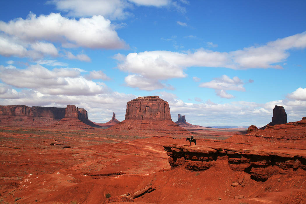A Navajo man on horseback takes in the views at Monument Valley Navajo Tribal Park. (Deborah Wall)