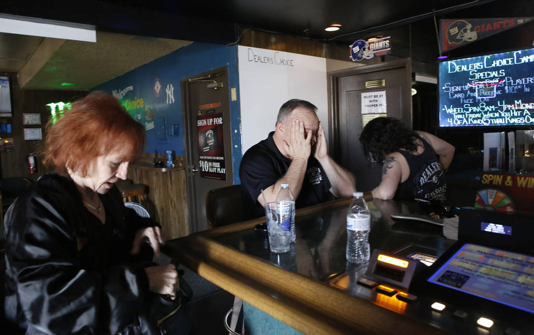 Irene Macieski, from left, Thomas Langrieger, 51, and Monique Garcia, 52, at Dealer's Choice Lounge on Friday, April 14, 2017, in Las Vegas. Langrieger reacts while thinking about the fact that he ...