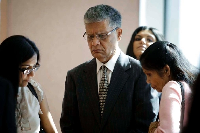 Dr. Dipak Desai is seen with his family Thursday before entering the courtroom for closing arguments in his hepatitis C outbreak trial at the Regional Justice Center. (Jessica Ebelhar/Las Vegas Re ...