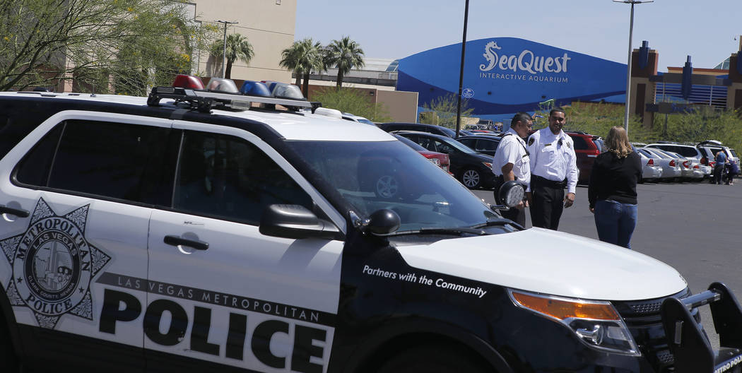Las Vegas police and private security guards watch a protest near Seaquest Interactive Aquarium at Boulevard Mall on Saturday, April 15, 2017, in Las Vegas. Former and current employees from Seaqu ...