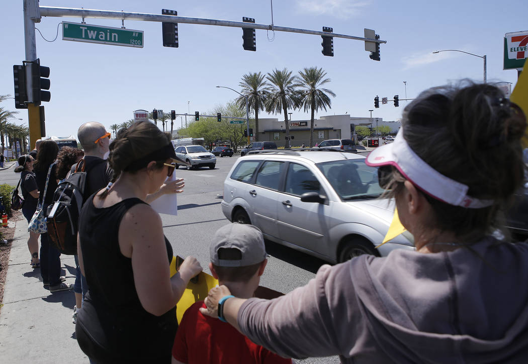 People protest against Seaquest Interactive Aquarium at Boulevard Mall on Saturday, April 15, 2017, in Las Vegas. Former and current employees from Seaquest have alleged that animals have been mis ...