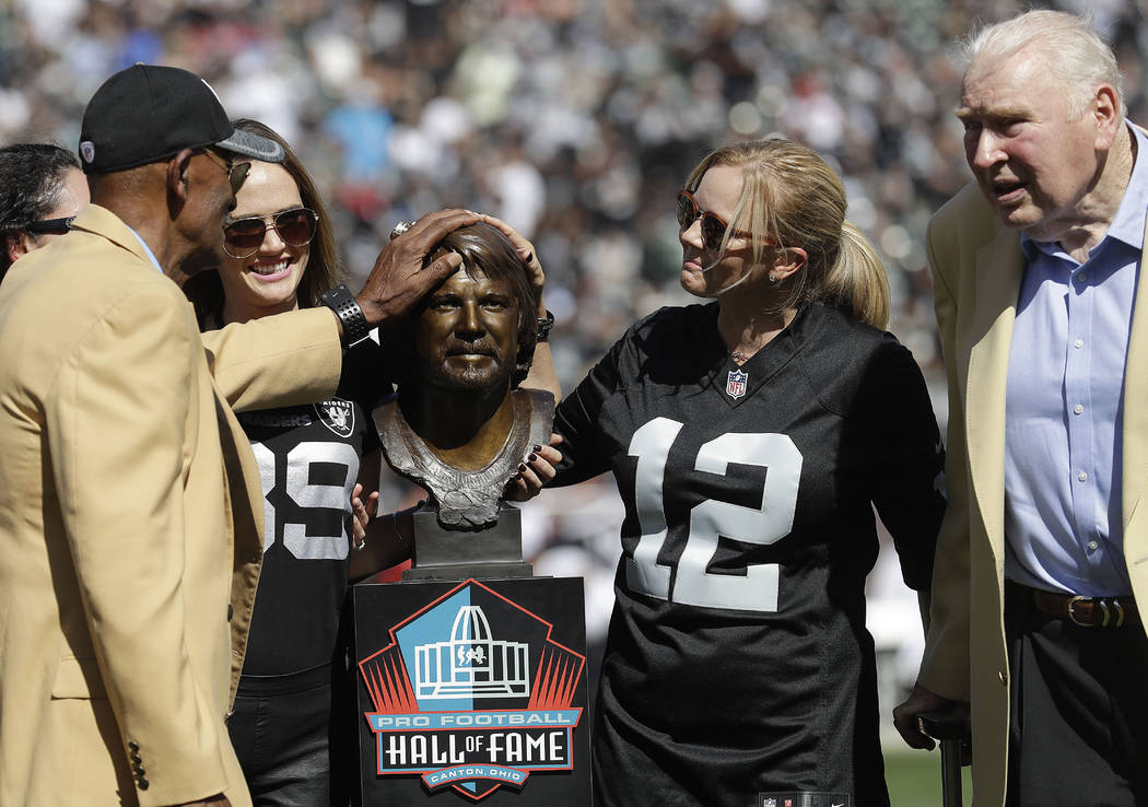 Former Oakland Raiders player Willie Brown, left, and former head coach John Madden, right, stand with family members of quarterback Ken Stabler next to Stabler's Pro Football Hall of Fame bust at ...