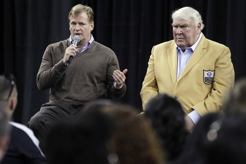 NFL Commissioner Roger Goodell, left, and Hall of Famer John Madden, right, participate in a fan forum before a football game between the Oakland Raiders and the Denver Broncos in Oakland, Calif., ...