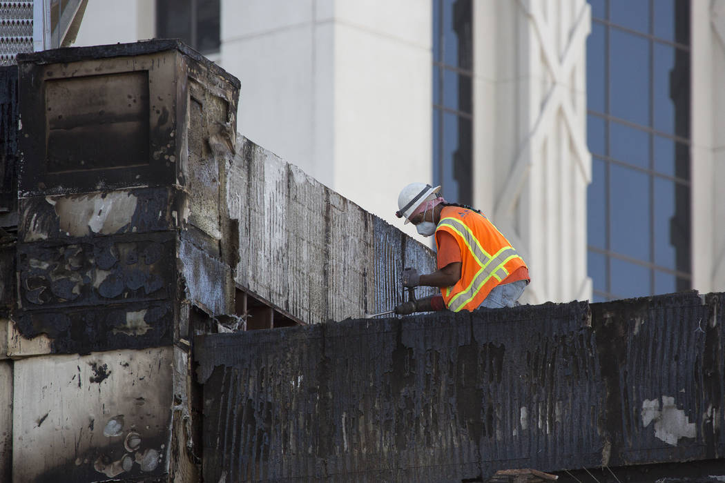 Damage from a roof fire the night prior is worked on at Bellagio hotel-casino on Friday, April 14, 2017 in Las Vegas. (Bridget Bennett/Las Vegas Review-Journal) @bridgetkbennett