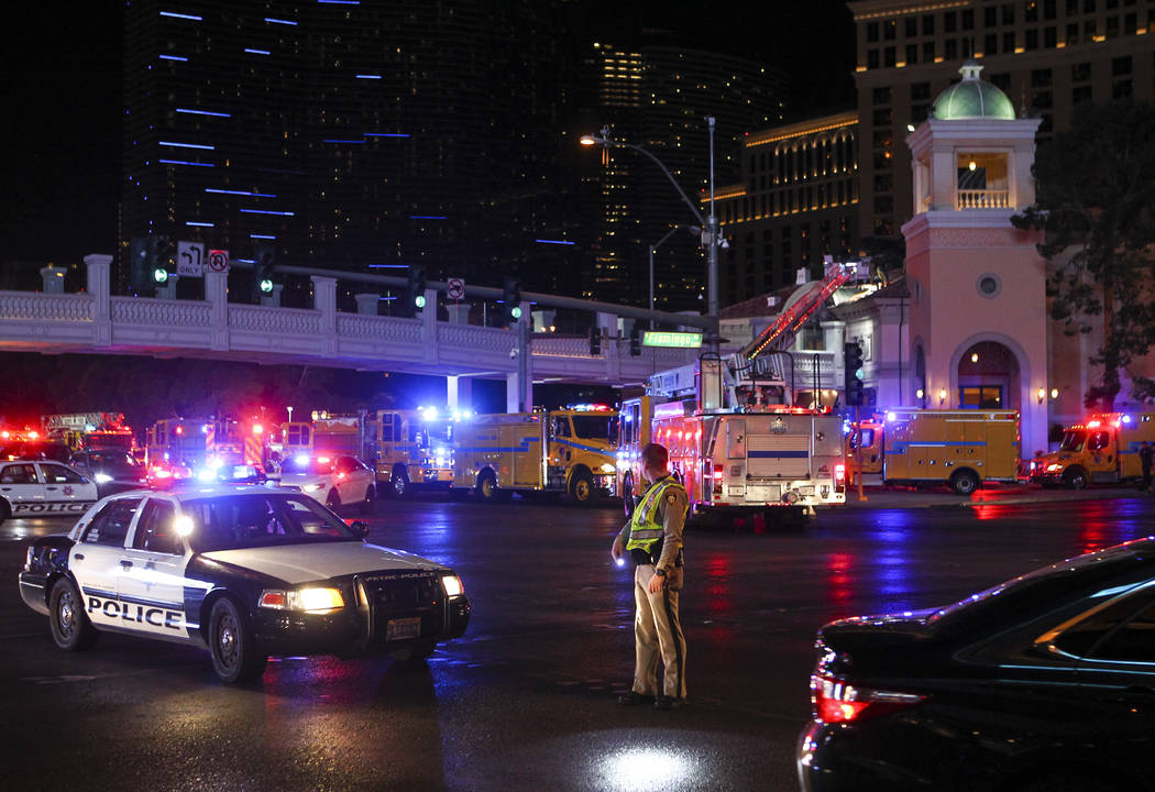 The Clark County Fire Department and other emergency personnel respond to the scene after part of the roof of the Bellagio hotel-casino caught fire in Las Vegas on Thursday, April 13, 2017. Chase  ...