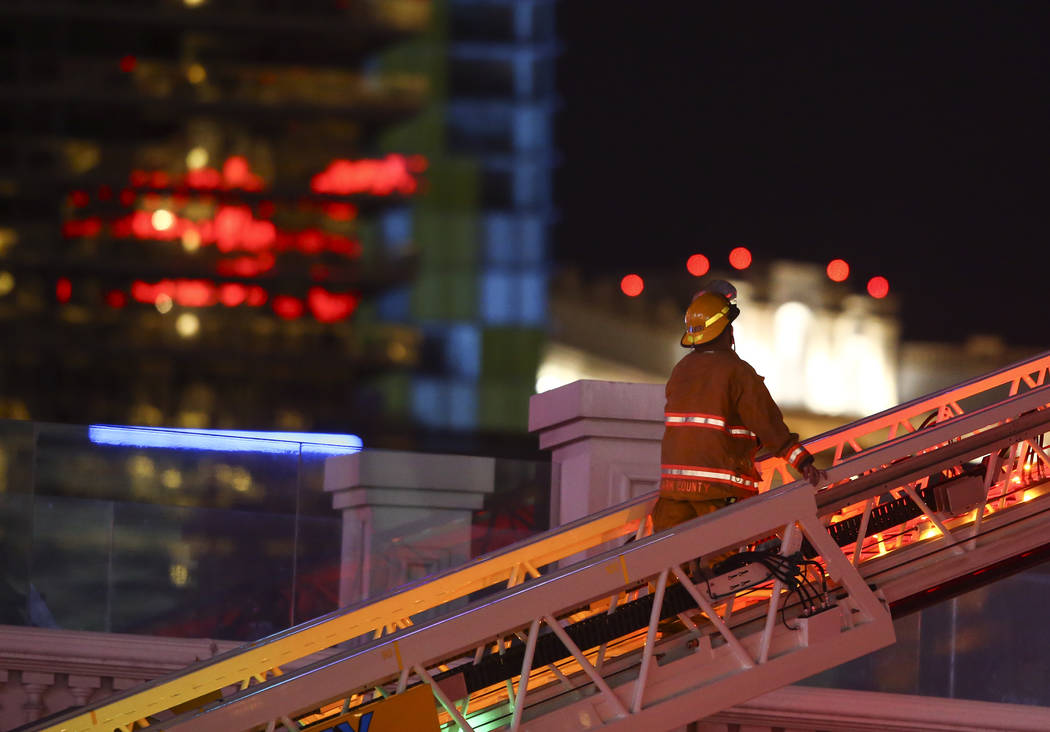 The Clark County Fire Department and other emergency personnel respond to the scene after part of the roof of the Bellagio hotel-casino caught fire in Las Vegas on Friday, April 14, 2017. Chase St ...