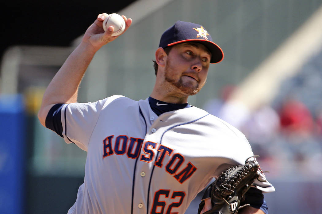 Houston Astros starter Brady Rodgers pitches to Los Angeles Angels in his major league debut in the first inning of a baseball game in Anaheim, Calif., Sunday, Oct. 2, 2016. (AP Photo/Reed Saxon)