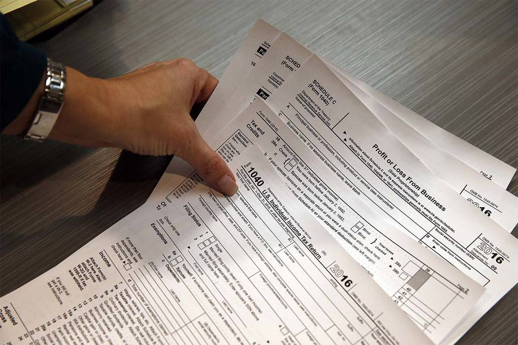 The deadline for filing taxes or asking for an extension is April 18 this year.  (Brennan Linsley/AP)