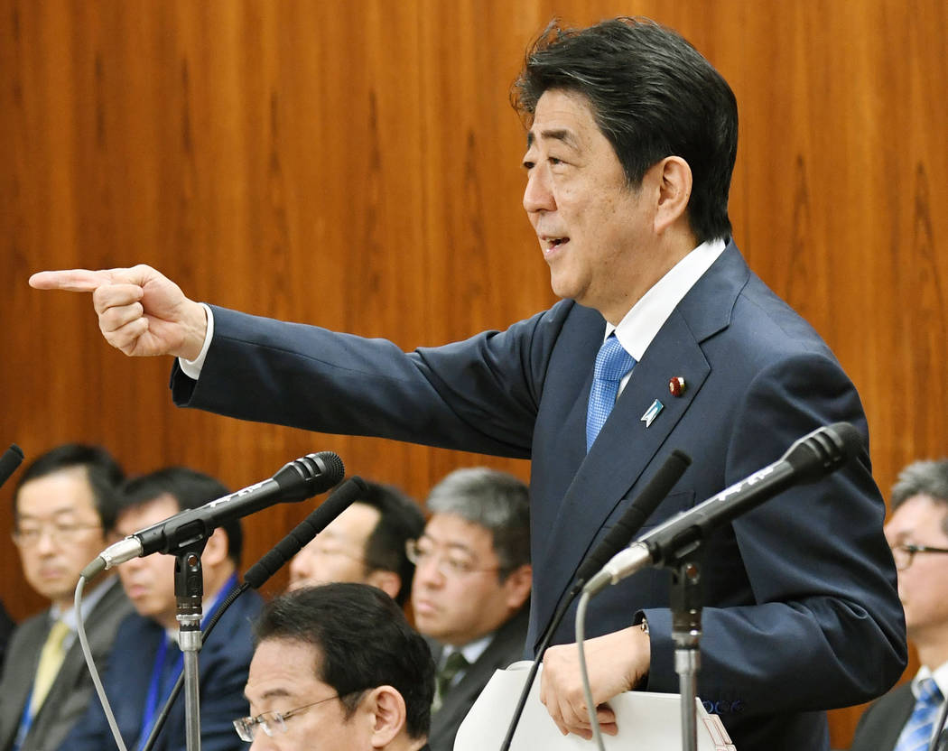 Japanese Prime Minister Shinzo Abe gestures while speaking at a parliamentary panel on national security and diplomacy at parliament's upper house in Tokyo Thursday, April 13, 2017. Abe warned tha ...