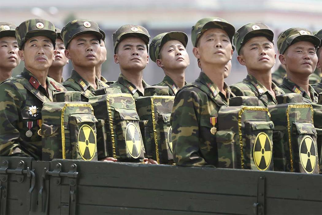 In this July 27, 2013, file photo, North Korean soldiers turn and look towards leader Kim Jong Un as they carry packs marked with the nuclear symbol at a parade in Pyongyang, North Korea. (Wong Ma ...