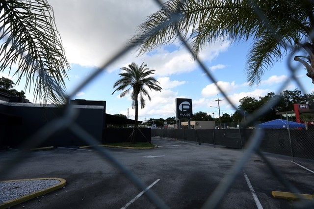 The Pulse night club sign is pictured through a fence following the mass shooting in Orlando, Florida. (Carlo Allegri/Reuters)
