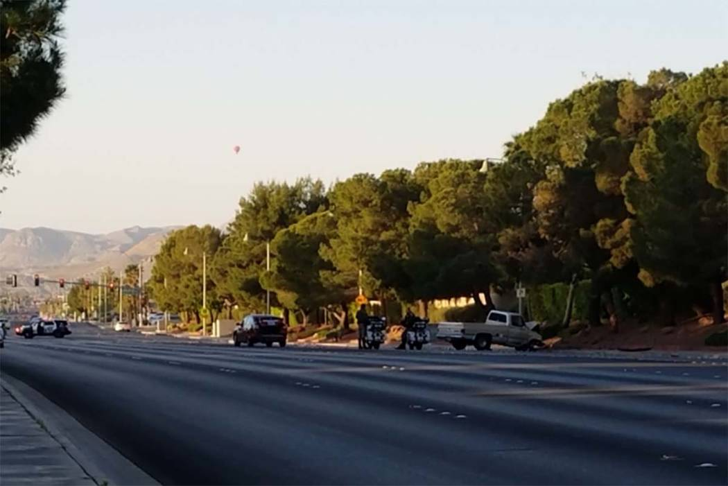 Police investigate a crash that has closed Fort Apache Road between Desert Inn Road and Lake South Drive in western Las Vegas, Friday, April 14, 2017. (Mike Shoro/Twitter/Las Vegas Review-Journal)