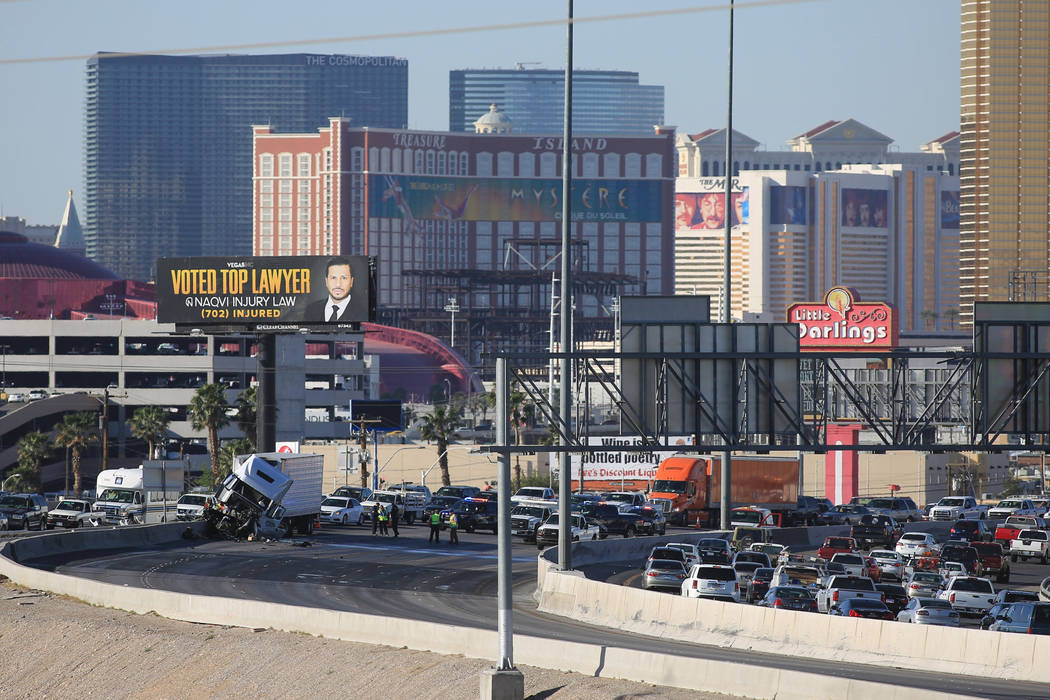 A semitrailer crash blocks northbound Interstate 15 near the Charleston Boulevard exit on Friday, April 14, 2017. (Brett Le Blanc Las Vegas Review-Journal) @bleblancphoto