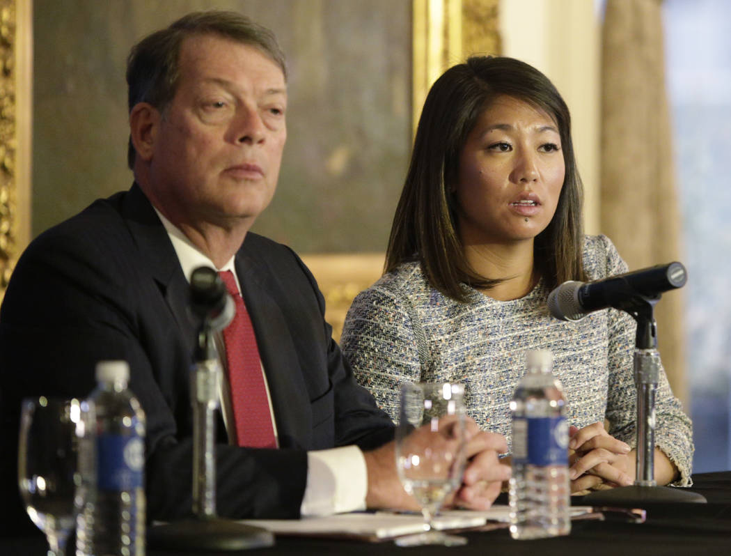 Crystal Pepper daughter of Dr. David Dao accompanied by attorney Stephen Golan, speaks at a news conference Thursday, April 13, 2017, in Chicago. Dao a passenger dragged from a United Express flig ...