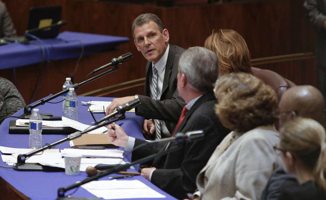 John Slater, a United Airlines vice president, testifies at a City Council committee hearing in Chicago on Thursday, April 13, 2017.  Slater said that bumping passengers to accommodate airline emp ...