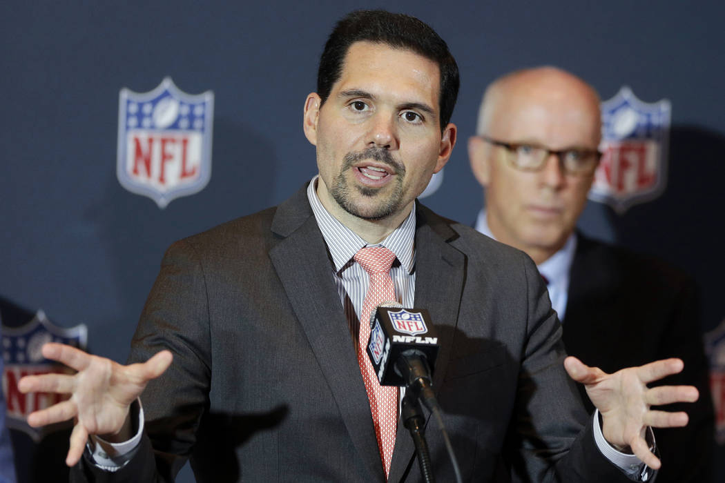 In this Monday, March 24, 2014, file photo, NFL vice president of officiating Dean Blandino speaks during a news conference, while Atlanta Falcons President, CEO and NFL competition committee memb ...