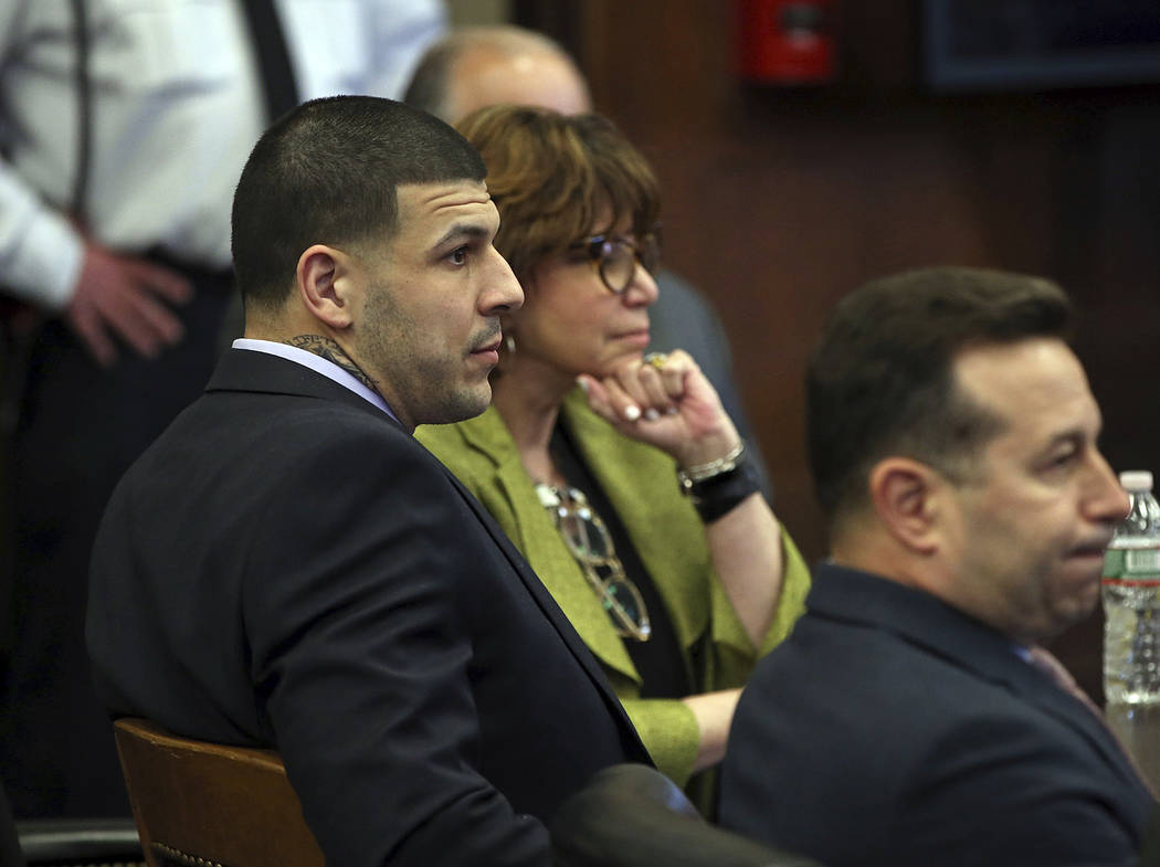 Former New England Patriots tight end Aaron Hernandez, left, sits at the defense table when court is adjourned without a verdict on day five of jury deliberations in his double murder trial at Suf ...