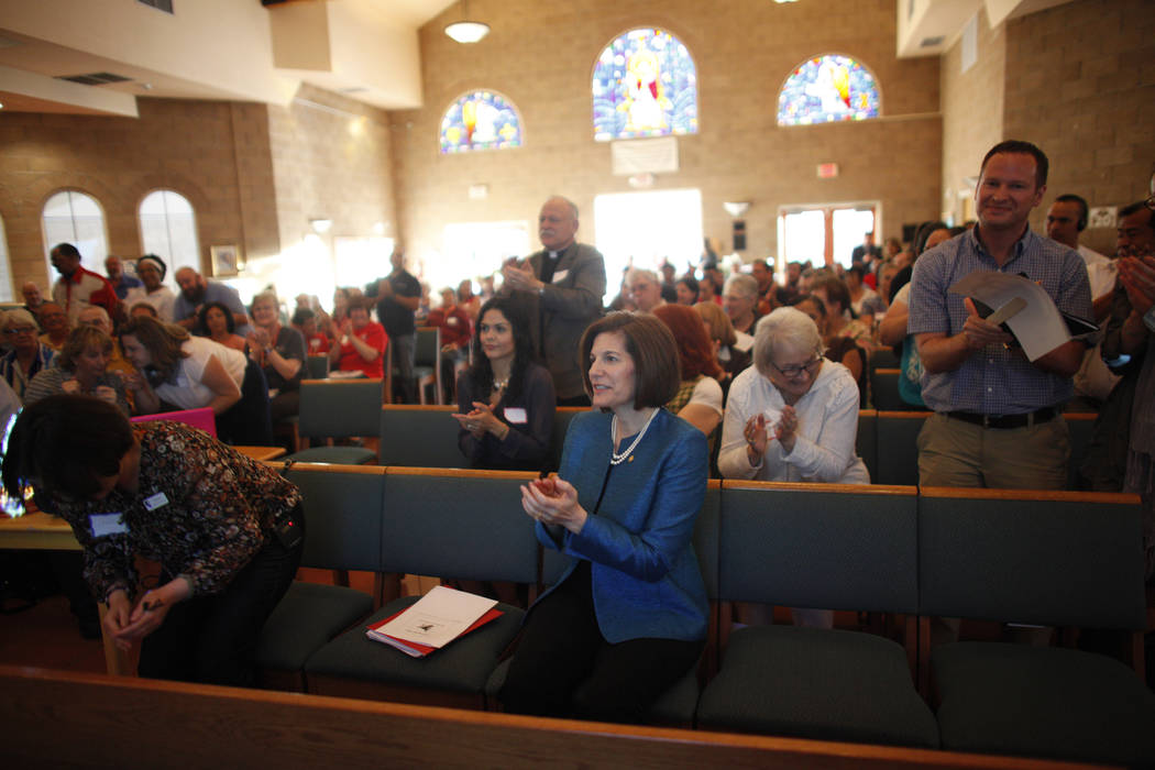 U.S. Senator Catherine Cortez Masto, D-Nev., center, applauds with the crowd an immigration forum hosted by the Nevadans for the Common Good on Monday, April 17, 2017, at the All Saints Episcopal  ...