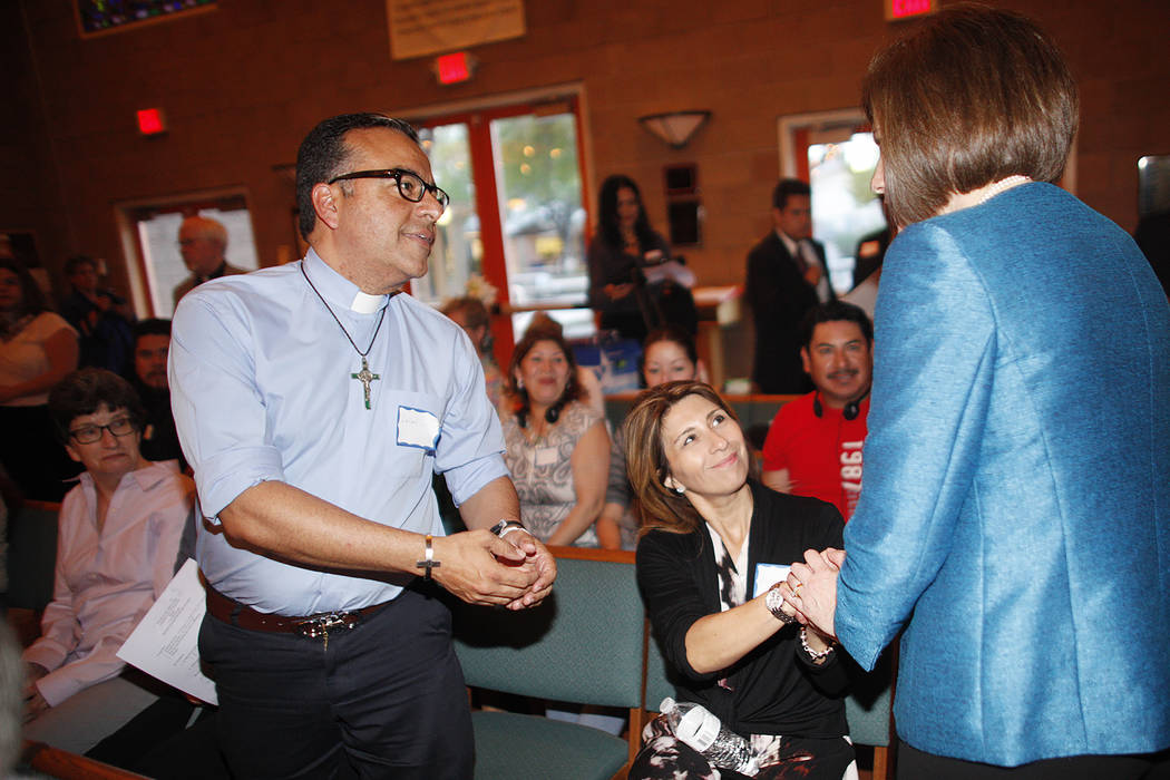 U.S. Senator Catherine Cortez Masto, D-Nev., shakes hands with Angela Scotaro and her husband Rafael Pereira as she leaves an immigration forum hosted by the Nevadans for the Common Good on Monday ...