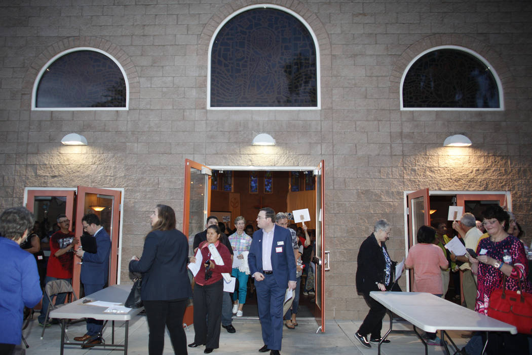 The crowd leaves the main building after an immigration forum hosted by the Nevadans for the Common Good on Monday, April 17, 2017, at the All Saints Episcopal Church in Las Vegas. Rachel Aston La ...