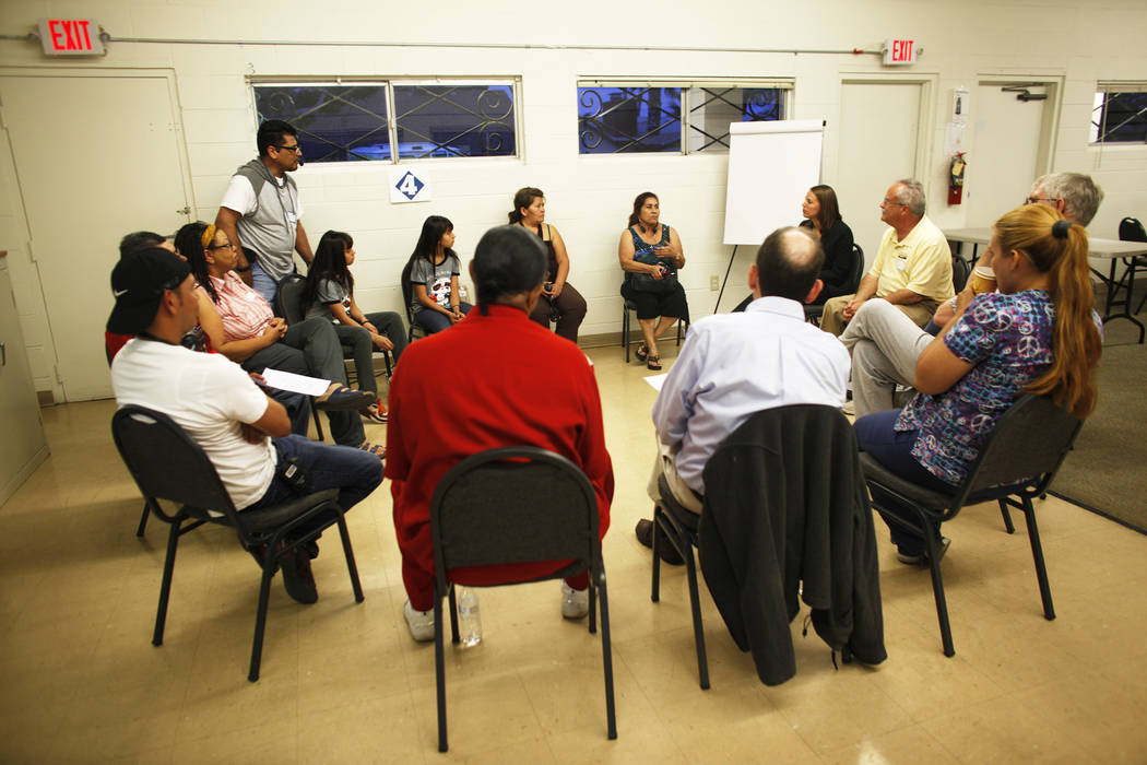 A group discusses personal immigration or migration stories after an immigration forum hosted by the Nevadans for the Common Good on Monday, April 17, 2017, at the All Saints Episcopal Church in L ...