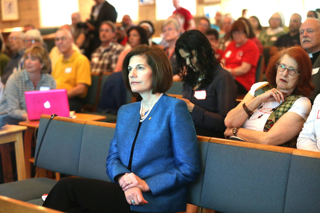 U.S. Senator Catherine Cortez Masto, D-Nev., listens to a speaker talk about the history of immigration at an immigration forum hosted by the Nevadans for the Common Good on Monday, April 17, 2017 ...