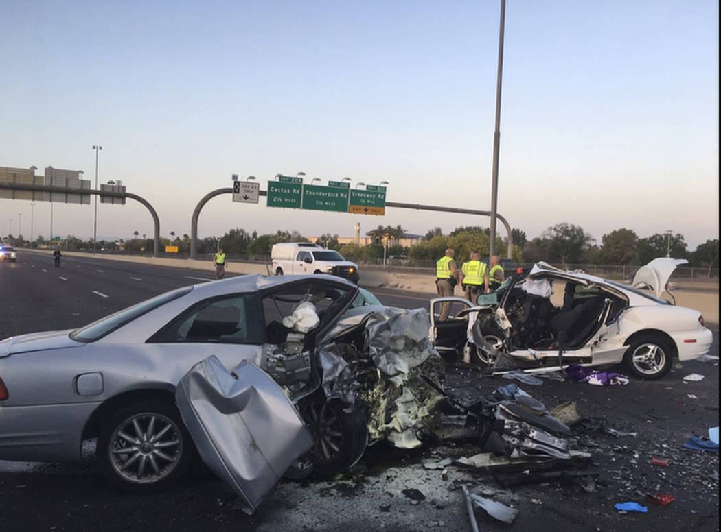 The mangled remains of cars involved in a fatal accident on the Northbound Interstate 17 in Phoenix, Ariz. on Friday, April 14, 2017. (Arizona Department of Public Safety via AP)