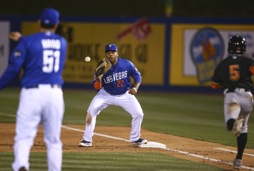 Las Vegas 51s first baseman Dominic Smith (22) catches the throw to get out Fresno Grizzlies infielder Tony Kemp (5) during a baseball game at Cashman Field in Las Vegas on Thursday, April 13, 201 ...