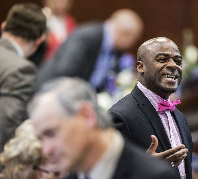 Sen. Kelvin Atkinson, D-North Las Vegas, interacts with colleagues in the Senate Chambers during the third day of the Nevada Legislative session on Wednesday, Feb. 8, 2017, at the Legislative Buil ...