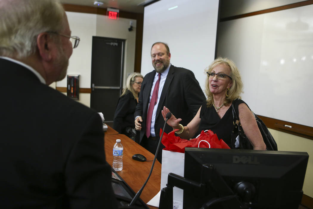 Former Las Vegas Mayor and Caesars Entertainment executive Jan Jones Blackhurst, right, greets attendees after giving the annual Robert D. Faiss Lecture on gaming law and policy at the Thomas &amp ...