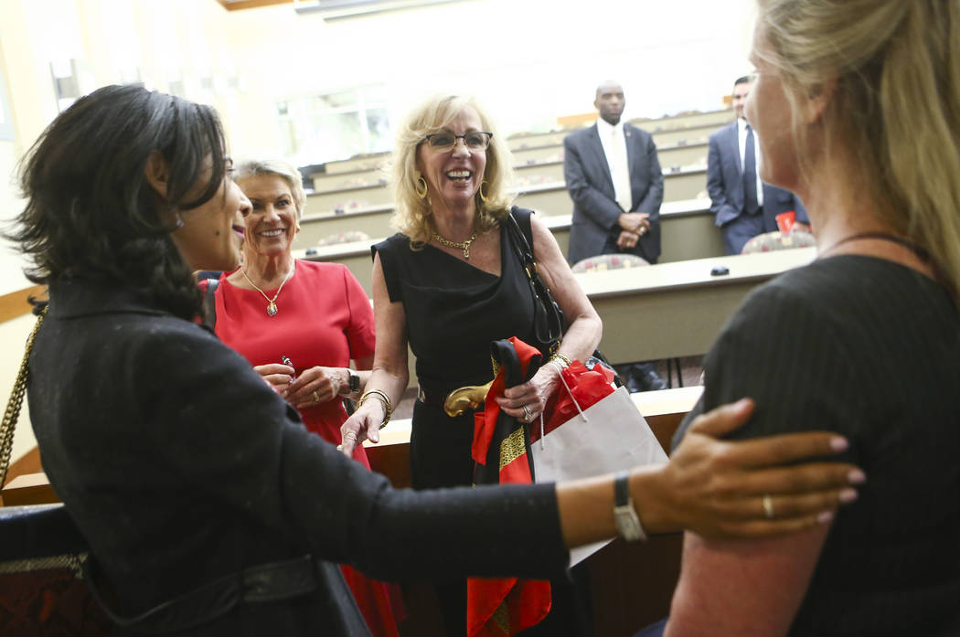 Former Las Vegas Mayor and Caesars Entertainment executive Jan Jones Blackhurst, center, greets attendees after giving the annual Robert D. Faiss Lecture on gaming law and policy at the Thomas &am ...