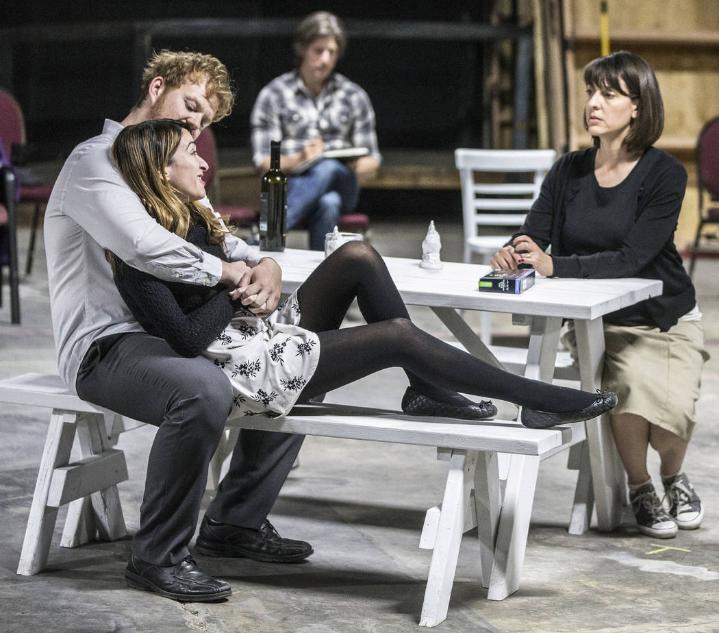 """Actors Mike Rasmussen, left, Rebecca Reyes and Tina Rici work through a scene during rehearsal for the comedy """"The Realistic Joneses"""" at A Public Fit Theater Company on Thursday, ..."""