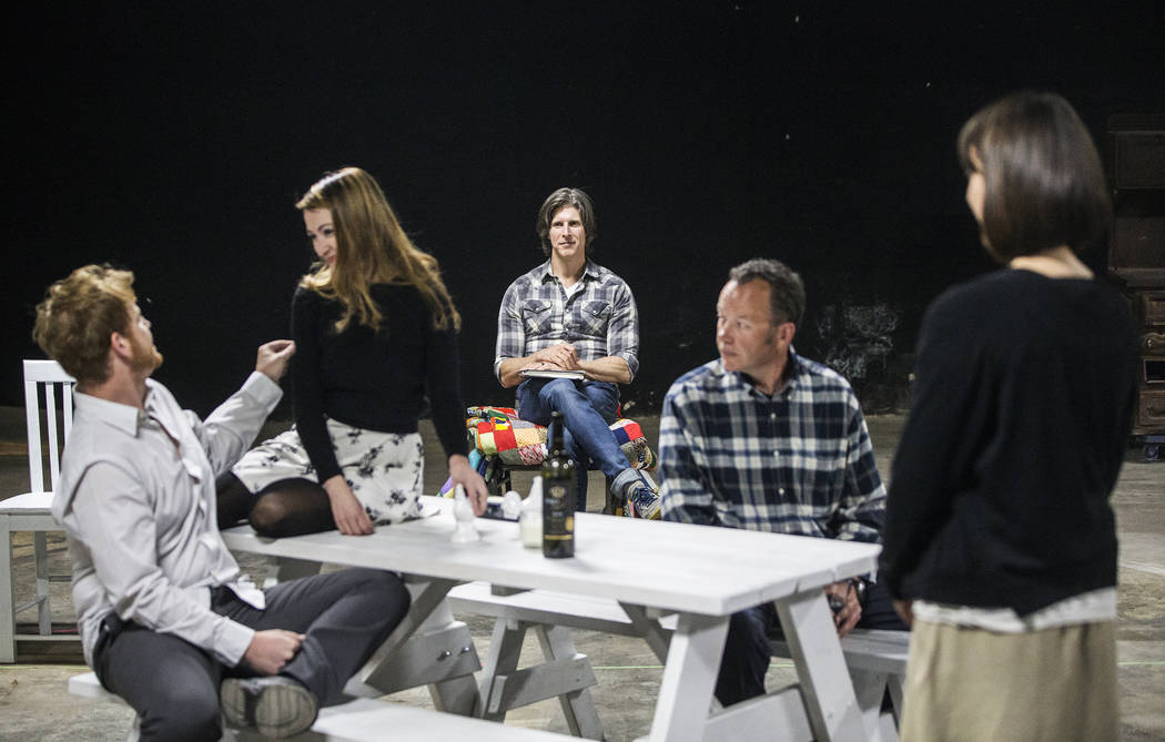 """Actors Mike Rasmussen, left, Rebecca Reyes, director Daniel Kucan, Timothy Cummings and Tina Rici work through a scene during rehearsal for the comedy """"The Realistic Joneses"""" at  ..."""