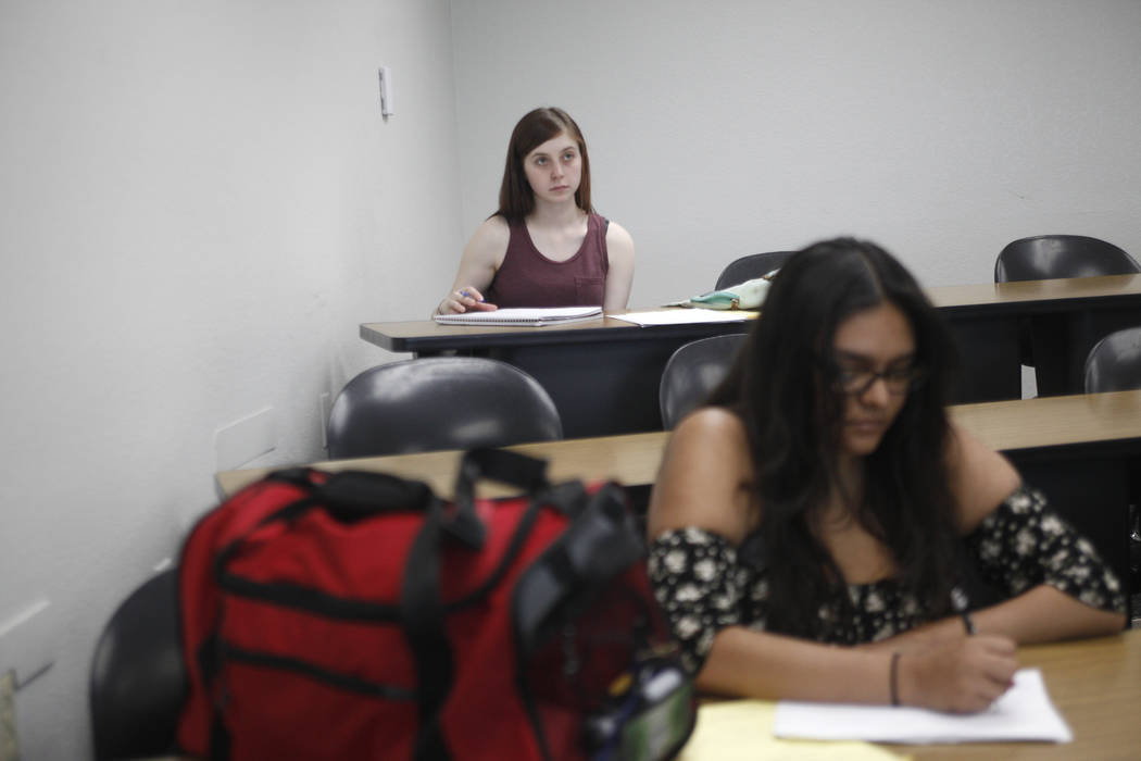 Rebecca Isacoff, from left, and Joanna Ruiz listen to the teacher at a remedial math class on Thursday, April 20, 2017, at UNLV in Las Vegas. Usually about 12 students attend. Rachel Aston Las Veg ...